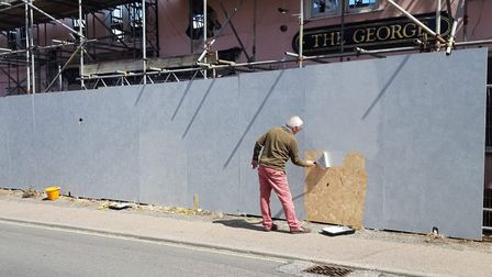 Hoardings get painted outside the George Pub in Wickham Market Picture: GEORGE COMMUNITY PUB