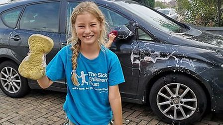 Lilly Stead, 9, washed cars to raise money for The Sick Children's Trust who supported her family wh