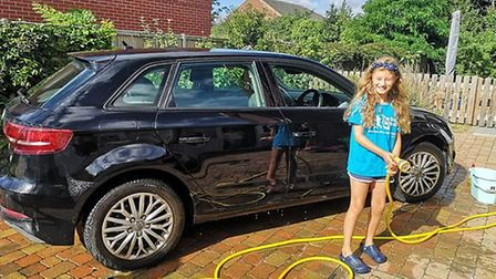 Lilly Stead, 9, washed cars to raise money for The Sick Children's Trust after her brother was rushe
