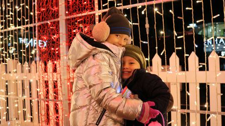 Daisy and Richie Farrow enjoying the Christmas lights in Bury last year Picture: CHARLOTTE BOND