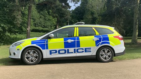A man dislocated his knee after being pinned against his car by another vehicle in a road rage incident in Stowmarket.