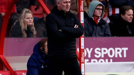 Town boss Paul Lambert, in the dug-out at Sincil Bank. Other League One managers are envious of his