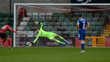 Tomas Holy is beaten from the penalty spot by Jorge Grant at Lincoln City. Picture Pagepix