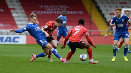 Jack Lancaster slides the ball forwards at Lincoln City. Picture Pagepix