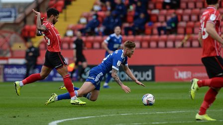 Teddy Bishop is fouled at Lincoln City. Picture Pagepix