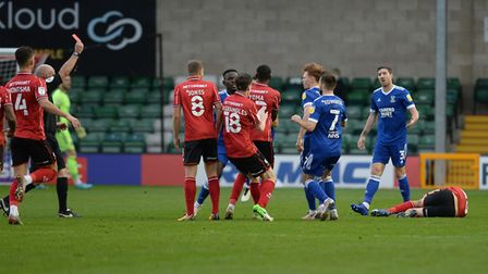 Tempers flare as Jon Nolan is shown a red card at Lincoln City. Picture Pagepix