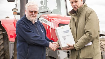 Fenland farmer Bill Legge with his beet prize from Bram van der Have