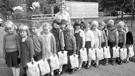 Children from St Mary's Primary School in Woodbridge with their harvest festival bags for the elderl