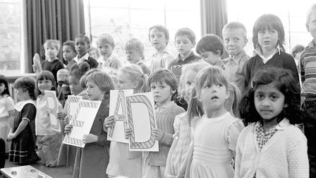 Pupils of Whitton Junior School in Ipswich putting on a show for harvest festival in 1985 Picture: