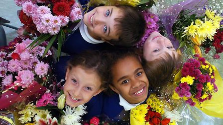 Ringshall Primary School pupils with bouquets they delivered to local residents as part of their har