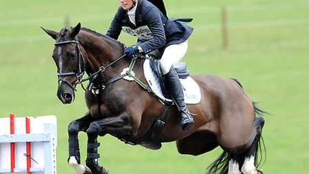 Zara Phillips on Black Tuxedo competing in the show jumping on day two of the Burnham Market Interna