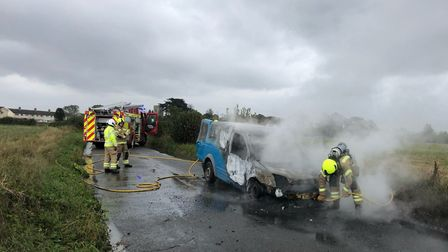 Firefighters were called to the country road in Great Wenham, after Darren Barton's van caught alight. Picture: SEB FRANKLIN