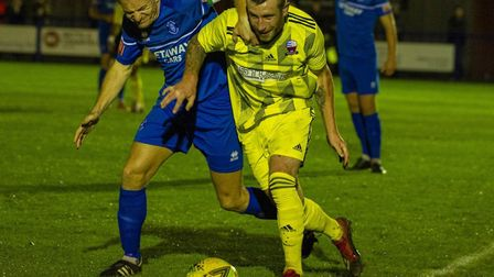 Ollie Hughes, who scored Bury Town's second goal, is quick to close down a Nuneaton Borough opponent