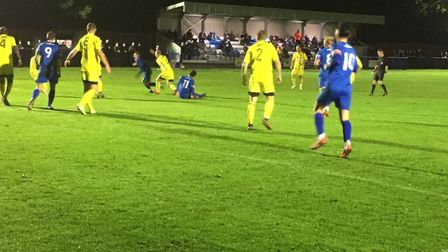 Max Maughn (No.11) is on the deck as Bury Town force the pace against Nuneaton Borough in an FA Cup
