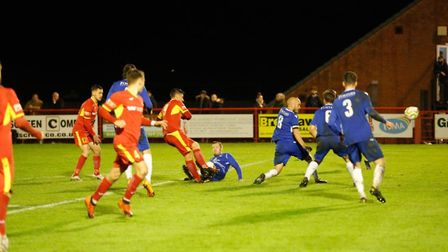 Billy Hunt fires home Needham Market's third goal in the 3-1 win over Lowestoft Town. Picture: TERRY