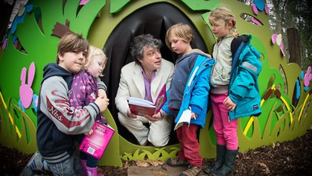 Tom Blofeld reading his latest book about the Easter Bunny at Bewilderwood. With Jack and Faith Smit