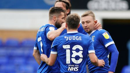 Freddie Sears is congratulated by teammates Alan Judge, Gwion Edwards and Emyr Huws, after he had sc