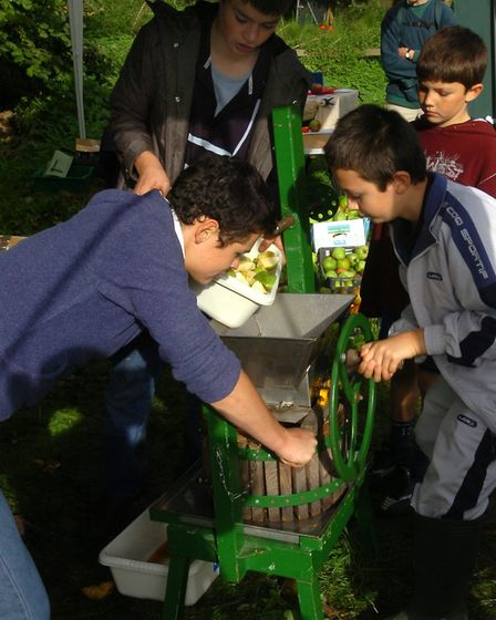 Using an apple press at Holywells Park Apple Day in Ipswich in 2006 Picture: SIMON PARKER/ARCHANT