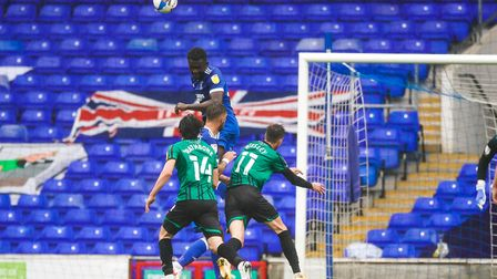 Toto Nsiala rises high to head clear against Rochdale. Picture: STEVE WALLER
