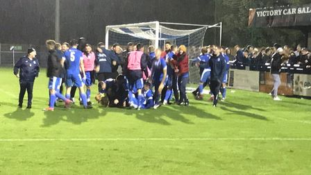 Leiston players and fans celebrate after their famous penalty shoot-out success over AFC Telford Uni