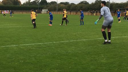Loughborough Dynamo keeper Ruben Rabstein looks on as Bury Town mount an attack. Picture: CARL MARST