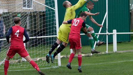 White Ensign keeper Louis Hawes punches clear during their 2-1 win at Whitton United in the FA Vase.