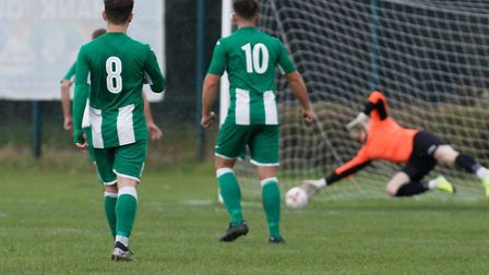 Whitton United keeper Jack Spurling gets a hand to Connor Barnby's low shot, during the 2-1 defeat t