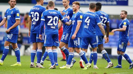 Town players celebrate with Freddie Sears, after his goal had taken them into a 2-0 lead against Acc