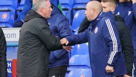 Town manager Paul Lambert and Accrington manager John Coleman bump fists after the game. Picture: