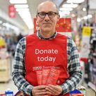 Supermarket volunteer with shopping list guide for donations in food collection appeal. Picture: Pet