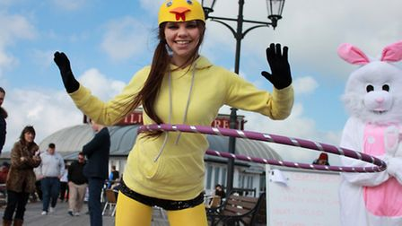 Hula Hooper Gabbi Ryan in action on Cromer Pier, watched by friends and family including 11-year-old