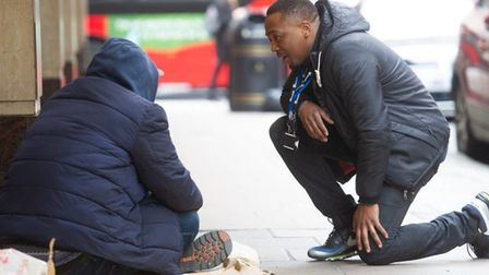 A Street Buddy reaching out to help a rough sleeper. Picture: Riverside Housing