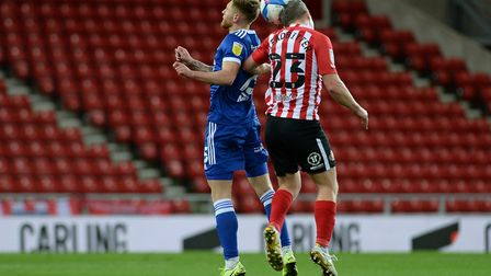 Teddy Bishop jumps for the ball with Grant Leadbitter at Sunderland Picture Pagepix Ltd