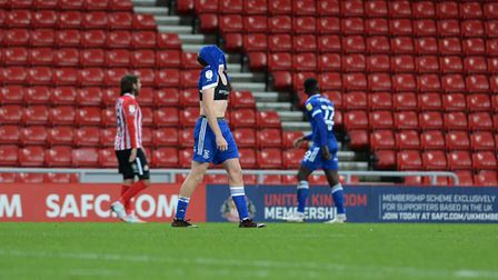 Disappointment for Ipswich's Mark McGuinness after he gave away a controversial late penalty at Sund