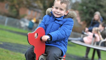 Children will be able to enjoy parks and playgrounds during the second lockdown. Connor using the equipment at Woolpit...