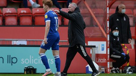 Jon Nolan gets consolation from his manager after he was shown a red card at Lincoln City. Picture P
