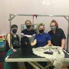 Emma Moon, second left, and her staff at Scruffy's dog grooming salon. Picture: Nadja Noel