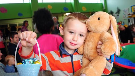 Children enjoy the games at the Sewell Toy Library Easter Trail. Three-year-old Kian Colby with some