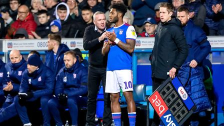 Town manager Paul Lambert has a word with Ellis Harrison, ahead of introducing him as a substitute.