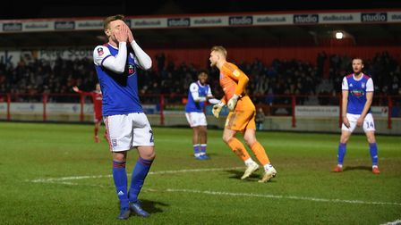 Freddie Sears covers his face after missing a chance during an FA Cup defeat at Accrington Stanley i