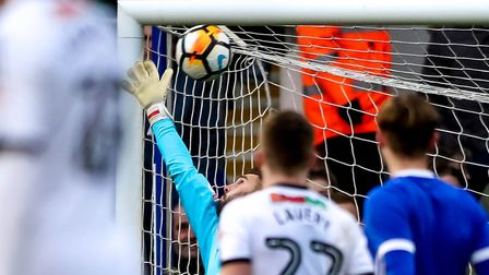 Bartosz Bialkowski is beaten by Nathan Thomas' super striker as Ipswich are knocked out of the FA Cu
