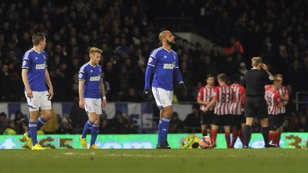 Ipswich Town's players look dejected after Southampton's FA Cup replay winner at Portman Road in 201