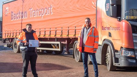 Lorry driver Tom Warner has been presented with a Going the Extra Mile award on behalf of Bacton Tr