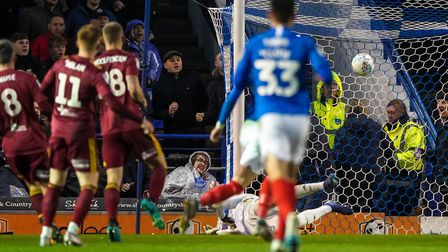Ronan Curtis (11) scores the only goal of the game as Portsmouth won in 2019. Picture: Steve Waller