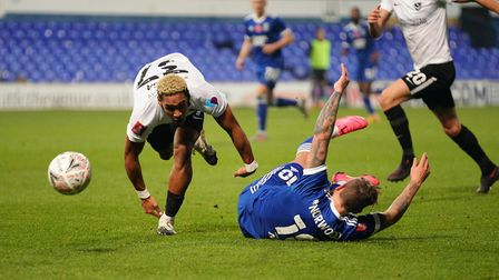 James Norwood wins a free kick after being bundled over by Haji Mnoga.Picture: Steve Waller