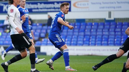 Jon Nolan watches as his shot goes in to pull a goal back for Town and reduce the first half deficit