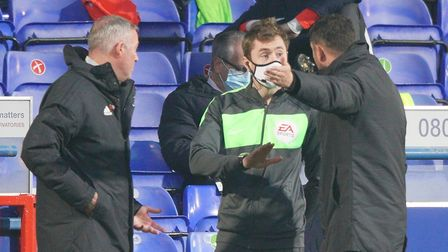 Town manager Paul Lambert and his assistant Stuart Taylor appeal to the fourth official after Oli Ha