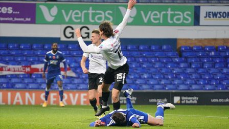 Oli Hawkins goes over in the penalty area after a challenge from Rasmus NicolaisenPicture: Stev