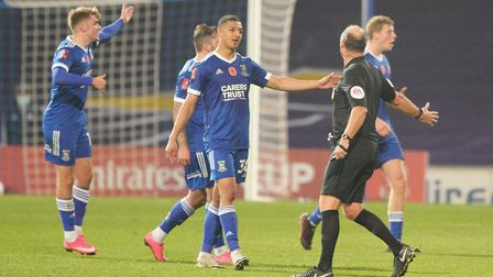 Myles Kenlock appeals to referee Andy Haines as his teammates ask questions of the linesman followin