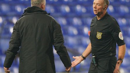 Town manager Paul Lambert speaks with referee Andy Haines after the final whistle, following his sid